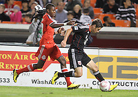 Devon McTavish #18 of D.C. United shields the ball from Nicholas Lindsay #37 of Toronto FC during an MLS match that was the final appearance of D.C. United's Jaime Moreno at RFK Stadium, in Washington D.C. on October 23, 2010. Toronto won 3-2.