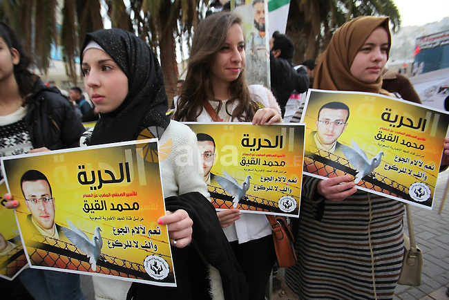 Palestinians take part in a demonstration demanding the release of Palestinian journalist Mohammed al-Qiq from Israeli jails, in the West Bank city of Nablus on Jan. 21, 2016. Qiq, a 33-year-old reporter for Saudi TV channel Al Majd, was arrested on November 21 at his home in the West Bank city of Ramallah and in mid-December placed under administrative detention, which allows imprisonment without trial for six-month periods renewable indefinitely. Photo by Nedal Eshtayah