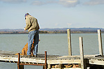 Sugar Island. Dick Couch on dock. St. Mary's River Channel with 'Gilly'.