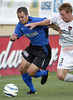 Brian Mullan (#9) and Chris Leitch (#3) in action during an MLS match between the San Jose Earthquakes and MetroStars on June 13, 2004 in San Jose, California.  San Jose defeated the MetroStars 3-1.