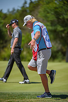 Caddie Damon Green performs his birdie dance as Zach Johnson (USA) tips his had to the crowd in the background after sinking his birdie putt on 2 during Round 4 of the Valero Texas Open, AT&amp;T Oaks Course, TPC San Antonio, San Antonio, Texas, USA. 4/22/2018.<br /> Picture: Golffile | Ken Murray<br /> <br /> <br /> All photo usage must carry mandatory copyright credit (&copy; Golffile | Ken Murray)