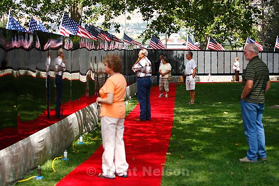 Provo - The Moving Wall, a half-size replica of the national Vietnam Veterans Memorial in Washington D.C., is on display in Provo. A steady stream of visitors paid their respects to the more than 58,000 names memorialized on the wall.