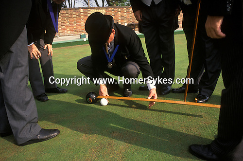 Knighthood of the Old Green, annual bowling competition at the Worlds Oldest Bowling Club Southampton Hampshire England. Measuring distance to see who  has won.