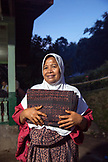 INDONESIA, Flores, a woman weaver in the town of Ende, a member of a weaving group called Bou Sama-Sama Ikat