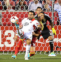 Goalie Nick Rimando #18 and Carlos Salcedo #16 of Real Salt Lake defends a shot on goal by Dwayne De Rosario #7 of D.C. United during the first half of the U.S. Open Cup Final on October  1, 2013 at Rio Tinto Stadium in Sandy, Utah.