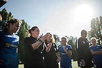 Seattle, Washington - Sunday, June 12, 2016: Seattle Reign FC head coach Laura Harvey celebrates with her team after a regular season National Women's Soccer League (NWSL) match at Memorial Stadium. Seattle won 1-0.