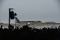 Trump supporters wait inside the Synergy Flight Center as Republican front runner Donald Trump's private jet arrives in Bloomington, Illinois on March 13, 2016.