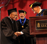 NWA Democrat-Gazette/ANDY SHUPE<br /> Judge L. Clifford Davis (left) is congratulated by Joseph Steinmetz (right), chancellor of the University of Arkansas, as James Coleman, provost, looks on Saturday, May 13, 2017, before Davis is awarded an honorary degree during commencement exercises in Bud Walton Arena in Fayetteville. Visit nwadg.com/photos to see more photographs from the ceremony.