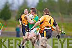 No way through for Shane O'Connor of Knocknagoshel as he gets sourrounded Asdee's defence last Saturday in the Novice Club Championship in Knocknagoshal.