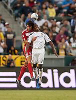 CARSON, CA – SEPTEMBER 10: FC Dallas defender George John and LA Galaxy forward Edson Buddle at Home Depot Center, September 10, 2010 in Carson California.
