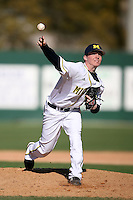 February 20, 2009:  Pitcher Tyler Burgoon (24) of the University of Michigan during the Big East-Big Ten Challenge at Jack Russell Stadium in Clearwater, FL.  Photo by:  Mike Janes/Four Seam Images