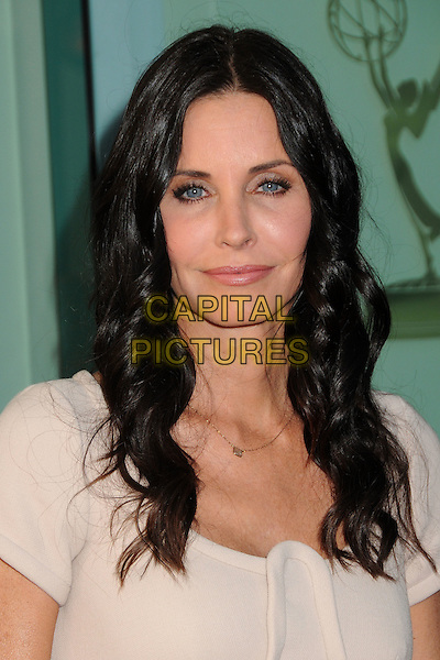 "COURTENEY COX.An Evening With ""Cougar Town"" held at the Academy Of Television Arts & Sciences, North Hollywood, California, USA, 20th April 2011..portrait headshot cream nude  wavy hair beauty .CAP/ADM/BP.©Byron Purvis/AdMedia/Capital Pictures."