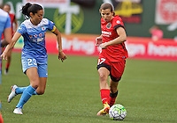 Portland, Oregon - Wednesday June 22, 2016: Portland Thorns FC midfielder Tobin Heath (17) controls the ball in front of Chicago Red Stars forward Christen Press (23) during a regular season National Women's Soccer League (NWSL) match at Providence Park.