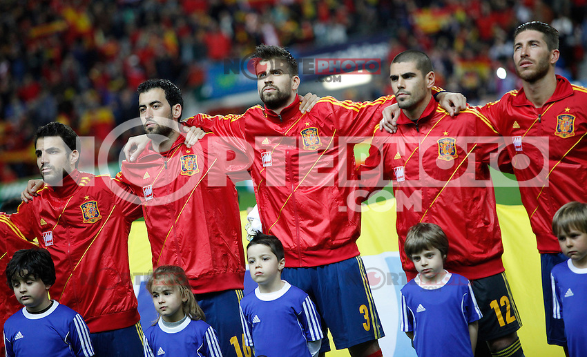 Spain's players listening to the national anthem before international match of the qualifiers for the FIFA World Cup Brazil 2014.March 22,2013.(ALTERPHOTOS/Victor Blanco)