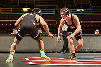 STANFORD, CA - January 18, 2015: Evan Silver of the Stanford Cardinal wrestling team competes during a meet against Cal Poly at Maples Pavilion. Stanford won 22-13.