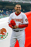 12 July 2008: Washington Nationals pitcher Luis Ayala smiles in front of the Mexican Flag during Hispanic Heritage Celebrations prior to a game against the Houston Astros at Nationals Park in Washington, DC. The Astros defeated the Nationals 6-4 in the second game of their 3-game series...Mandatory Photo Credit: Ed Wolfstein Photo