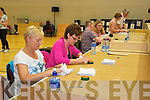 Count Centre Staff at the Killarney Sports and Leisure Centre count the votes from the referendum on Friday.....................