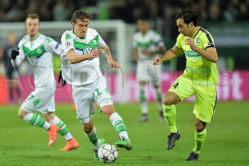 08.03.2016. Wolfsburg, Germany.  Max Kruse forward of VfL Wolfsburg is challenged by Rafinha Scapini De Almeida Rafael defender of KAA Gent during the Champions League Round of 16, second leg match between VfL Wolfsburg and KAA Gent at the Volkswagen Arena in Wolfsburg, Germany.