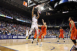 12 March 2015: Notre Dame's Zach Auguste (30) shoots over Miami's Ivan Cruz Uceda (ESP) (33). The Notre Dame Fighting Irish played the University of Miami Hurricanes in an NCAA Division I Men's basketball game at the Greensboro Coliseum in Greensboro, North Carolina in the ACC Men's Basketball Tournament quarterfinal game. Notre Dame won the game 70-63.
