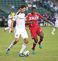 CARSON, CA – July 9, 2011: LA Galaxy defender Omar Gonzalez (4) and Chicago Fire forward Cristian Nazarit (29) during the match between LA Galaxy and Chicago Fire at the Home Depot Center in Carson, California. Final score LA Galaxy 2, Chicago Fire FC 1.