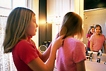 Girls brushing hair