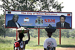 NDOLA, ZAMBIA MARCH 25: A sign welcomes Chinese Premier H.E Hu Jintao and Zambian President H.E Levy .P. Mwanawasa to Ndola on March 25, 2007 in Ndola, Zambia. Mr. Hu Jintao visited Africa in early 2007 and also Zambia.  Chinese are investing in primarily copper mines in northern Zambia. Tens of thousands of Chinese has come to Africa the last years to work in infrastructure projects and businesses. Chinese companies are often the lowest bidders for contracts, pricing out the more expensive European companies. The Chinese people often live where they work and rarely interact with the local population. Most Chinese don't speak English and they are mostly staying in the compounds cooking their Chinese food, and watching Chinese Television and DVDs. (Photo by Per-Anders Pettersson)..