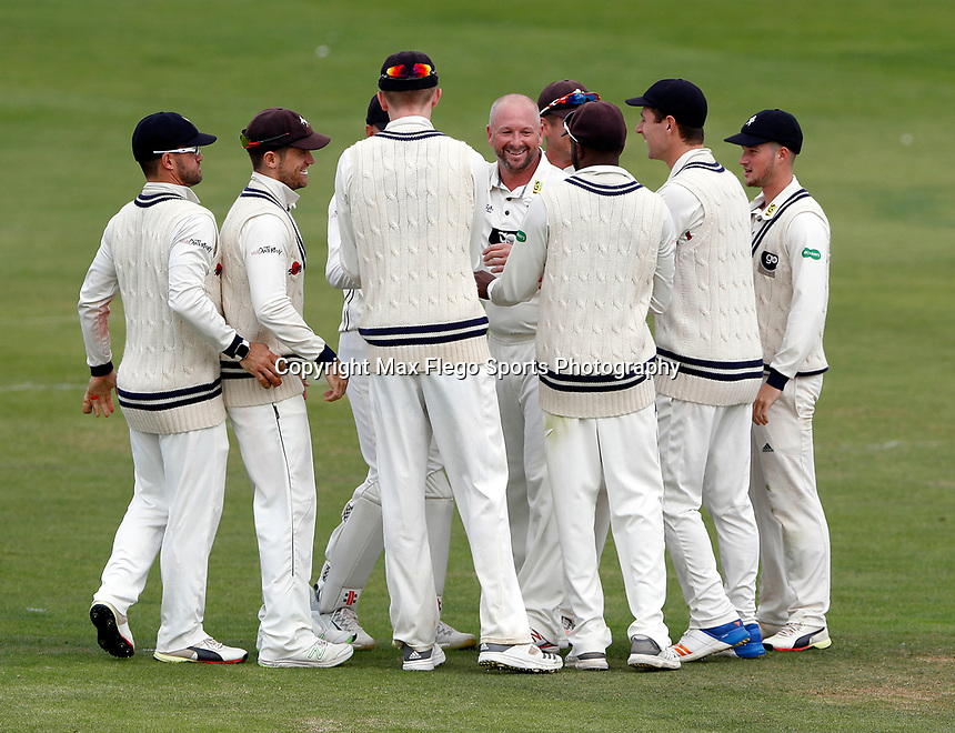 Darren Stevens (C) of Kent is hailed by his teammates after taking the wicket of Chris Cooke during the Specsavers County Championship division two game between Kent and Glamorgan (day 3) at the St Lawrence Ground, Canterbury, on Sept 20, 2018