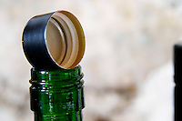 Bottle neck with screw cap fitting and screw cap cork. Chateau de Lascaux, Vacquieres village. Pic St Loup. Languedoc. France. Europe.