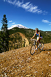 California: Biking near Mt. Shasta.  Model released..Photo copyright Lee Foster, 510/549-2202, lee@fostertravel.com, www.fostertravel.com..Photo #: calass105