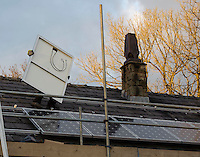 Fitting solar PV (photovoltaic) panels to a house near Chipping, Lancashire.