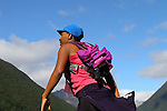 NELSON LAKES, NEW ZEALAND - APRIL 18:  Constance Takawira crosses the Travers River during the 2015 Alpine Lodge Loop The Lake trail run at Lake Rotoiti on April 18 16, 2015 in Nelson, New Zealand. (Photo by Marc Palmano/Shuttersport Limited)