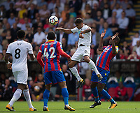 Swansea City's Kyle Naughton wins a header from Crystal Palace's Christian Benteke     <br /> <br /> <br /> Photographer Craig Mercer/CameraSport<br /> <br /> The Premier League - Crystal Palace v Swansea City - Saturday 26th August 2017 - Selhurst Park - London<br /> <br /> World Copyright &copy; 2017 CameraSport. All rights reserved. 43 Linden Ave. Countesthorpe. Leicester. England. LE8 5PG - Tel: +44 (0) 116 277 4147 - admin@camerasport.com - www.camerasport.com