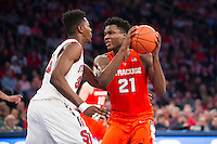 NEW YORK, NY - Sunday December 13, 2015: Tyler Roberson (#21) of Syracuse  runs into traffic in the lane.  St. John's defeats Syracuse 84-72 during the NCAA men's basketball regular season at Madison Square Garden in New York City.