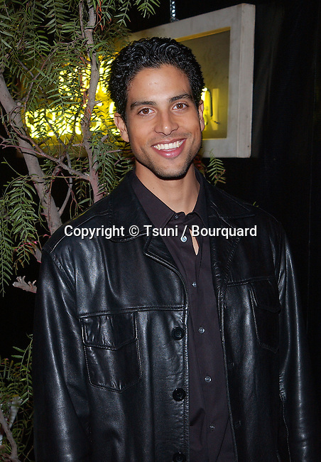 Adam Rodriguez arriving at the UPN private party for ROSWELL cast members and  winners of 20 major market national radio contest on the stage 30 on the Paramount lot in Los Angeles.  November 17, 2001           -            RodriguezAdam04.jpg