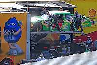 Sept. 21, 2008; Dover, DE, USA; The car of Nascar Sprint Cup Series driver Kyle Busch is pushed into the hauler after falling out of the race with engine problems during the Camping World RV 400 at Dover International Speedway. Mandatory Credit: Mark J. Rebilas-