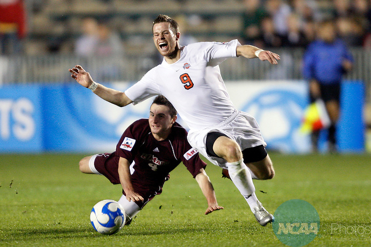 14 DEC 2007:  Midfielder Geoff Marsh (9) of Ohio State University is tripped up by midfielder Ben Arikian (4) of the University of Massachusetts during the Division I Men's Soccer Championship held at the SAS Soccer Park in Cary, NC.   Ohio State defeated UMass 1-0 to advance to the national championship title game.  Jamie Schwaberow/NCAA Photos