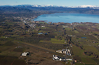 aerial photograph of Lampson Field airport, Lakeport, Lake County, California toward Lakeport and Clear Lake during the winter; north of Lakeport in the background are the mountains of the Mendocino National Forest, including, in the center background, Snow Mountain, part of the Snow Mountain Wilderness. The summit of East Snow Mountain's has an elevation of 7056, the highest elevation in Lake County.