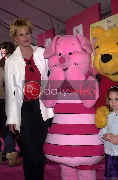 """Melanie Griffith and her daughter with """"Piglet"""" and """"Winnie The Pooh"""""""