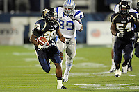 4 December 2010:  FIU running back Darriet Perry (28), pursued by Middle Tennessee defensive end Dearco Nolan (89), turns a short pass into a 30 yard gain in the second quarter as the Middle Tennessee State University Blue Raiders defeated the FIU Golden Panthers, 28-27, at FIU Stadium in Miami, Florida.