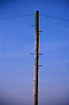 A912M2 Telegraph pole and wire against blue sky background
