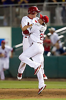 Ryan Jackson (23) of the Springfield Cardinals is tackled by Shelby Miller (26) after hitting the game winning base hit during a game against the Midland RockHounds at Hammons Field on July 11, 2011 in Springfield, Missouri. (David Welker / Four Seam Images)