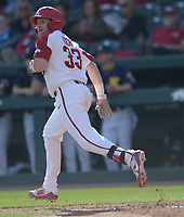 NWA Democrat-Gazette/ANDY SHUPE<br />Arkansas catcher Grant Koch watches as a 2-run home run sails over the fence against Kent State Friday, March 9, 2018, during the second inning at Baum Stadium in Fayetteville. Visit nwadg.com/photos to see more photographs from the game.