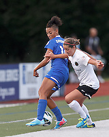 Boston Breakers forward Lianne Sanderson (10) attempts to control the ball as Portland Thorns FC forward Danielle Foxhoven (9) pressures. In a National Women's Soccer League (NWSL) match, Boston Breakers (blue) defeated Portland Thorns FC (white/black), 2-1, at Dilboy Stadium on August 7, 2013.