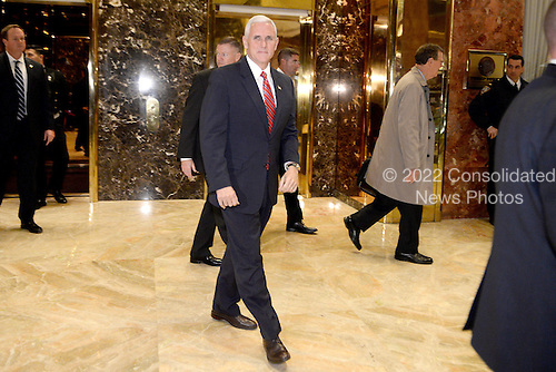 United States Vice President-elect Mike Pence is seen leaving Trump Tower in New York, New York, on November 28, 2016. <br /> Credit: Anthony Behar / Pool via CNP