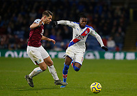30th November 2019; Turf Moor, Burnley, Lanchashire, England; English Premier League Football, Burnley versus Crystal Palace; Wilfried Zaha of Crystal Palace goes past James Tarkowski of Burnley - Strictly Editorial Use Only. No use with unauthorized audio, video, data, fixture lists, club/league logos or 'live' services. Online in-match use limited to 120 images, no video emulation. No use in betting, games or single club/league/player publications