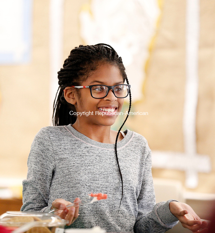 """Woodbury, CT- 14 December 2016-121416CM05-  Sierra Reynolds, 9 of Woodbury, makes a holiday cookie decoration at The Woodbury Public Library on Wednesday.  The library's teen advisory board hosted a holiday program which allowed participants to make a """"reindeer"""" bottle of rootbeer, holiday cookies decorations and crafts.  Christopher Massa Republican-American"""