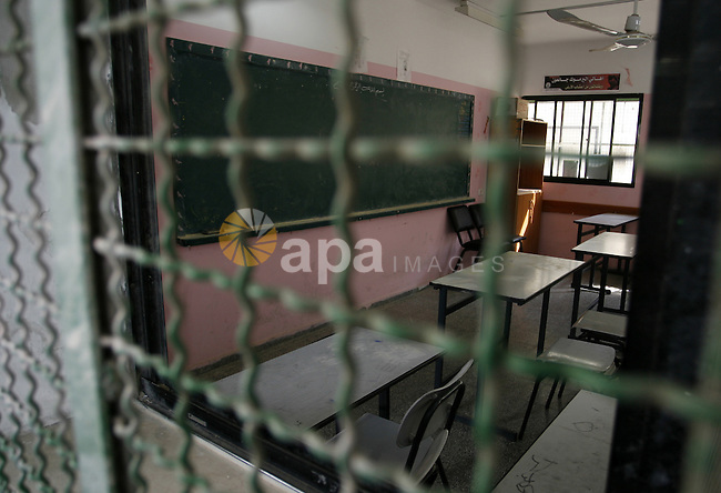A view into a closed School during the strike of the employees of former Palestinian government in Gaza Strip to demand for pay their salaries, in Rafah in the southern Gaza strip, on Oct. 15, 2014. Photo by Abed Rahim Khatib