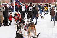 Saturday March 6 , 2010   Zach Steer and Lance Mackey stop along the trail amongst a crowd of spectaors during the ceremonial start of the 2010 Iditarod in Anchorage , Alaska