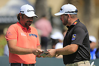 Victor Dubuisson (FRA) and Graeme McDowell (NIR) on the 1st during the final round of  the Saudi International powered by Softbank Investment Advisers, Royal Greens G&CC, King Abdullah Economic City,  Saudi Arabia. 02/02/2020<br /> Picture: Golffile | Fran Caffrey<br /> <br /> <br /> All photo usage must carry mandatory copyright credit (© Golffile | Fran Caffrey)