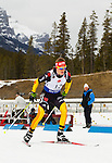 German biathlon athlete Doll Benedikt just out of the start Gate at The International Biathlon Union Cup #6 Men's 10 KM Sprint held at the Canmore Nordic Center in Canmore Alberta, Canada, on Feb 12, 2012.  Doll placed 3rd in the race.